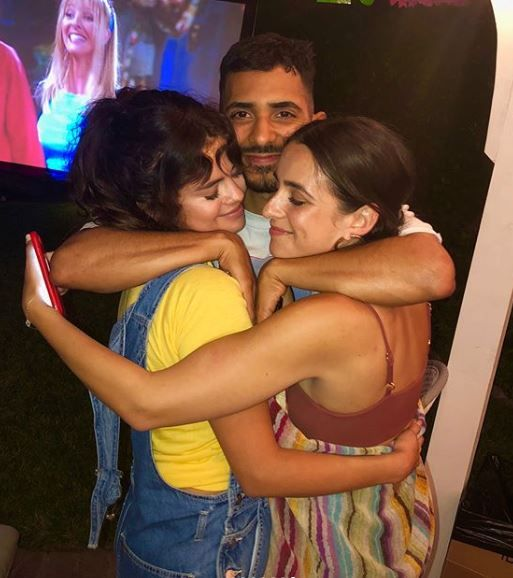 5 selena gomez - hugging her friends at a party