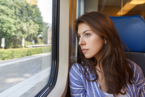 Internal broke my heart - girl in train thinking