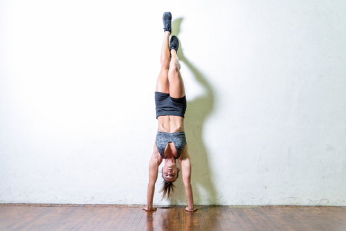 7 toned arms - headstands against the wall for support