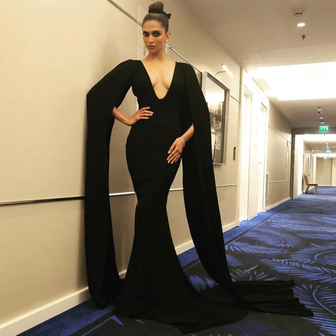 1. deepika padukone black gown with a plunging neckline