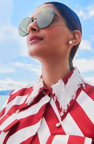 sonam kapoor look 2 red and white stripe dress with heels outdoors nude makeup sleek ponytail cannes 2018