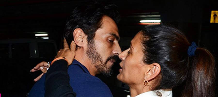 Arjun rampal and mehr jessia kissing at a party