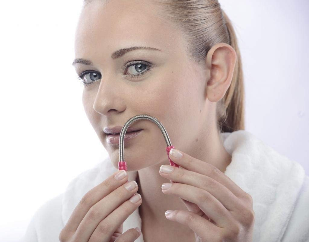 girl using hair removal beauty tool to remove facial hair