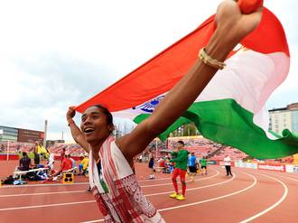 hima das running on the track with Indian flag