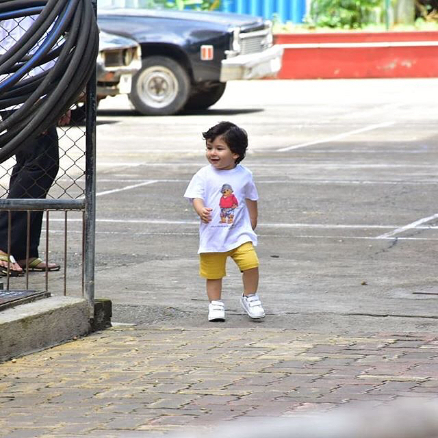 1 taimur ali khan - white t-shirt yellow shorts