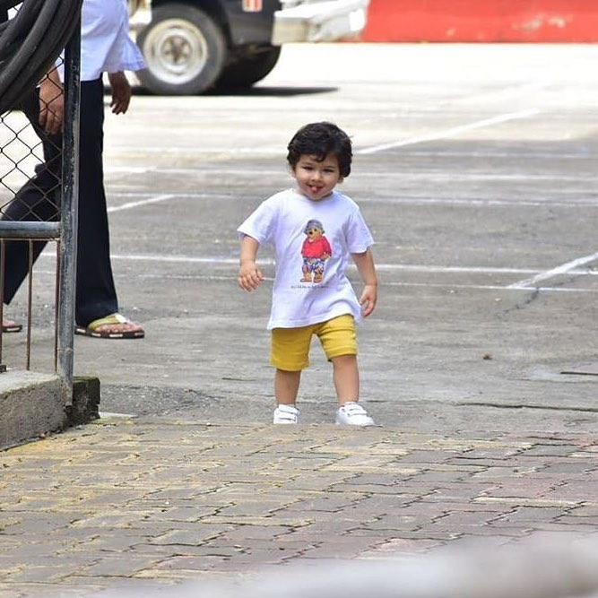 4 taimur ali khan - showing his tongue to photographers