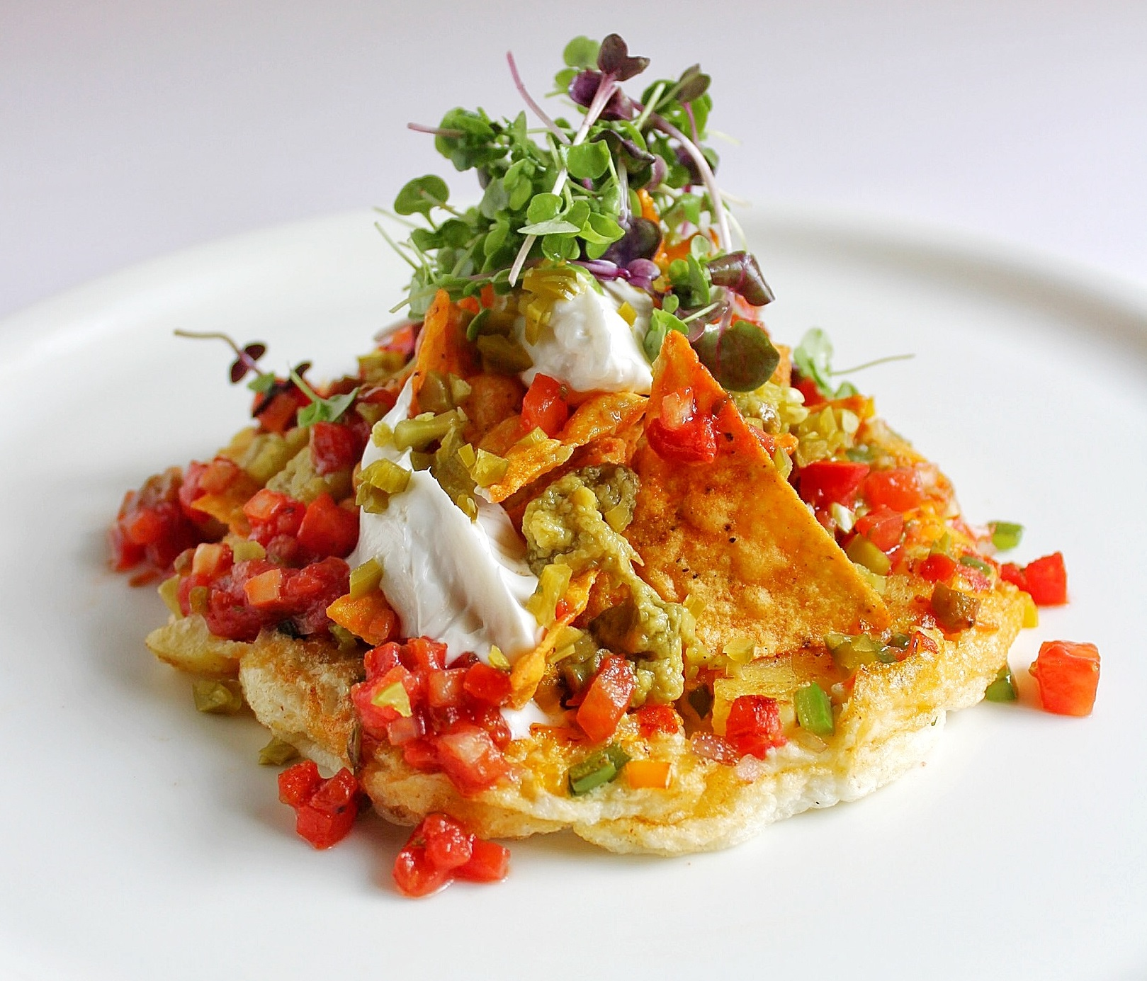 Spanish omlette with nachos   spicy salsa