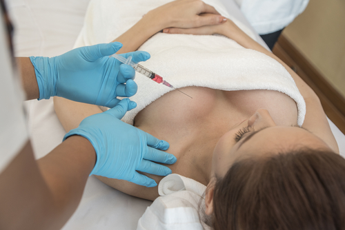 breast reduction surgery cosmetic procedure doctor with injection before breast augmentation surgery
