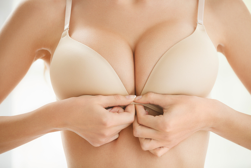 general information about breasts what are they made up of woman unhooking her bra from the front