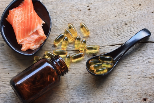 start eating fish and taking fish oil supplements to reduce breast size naturally