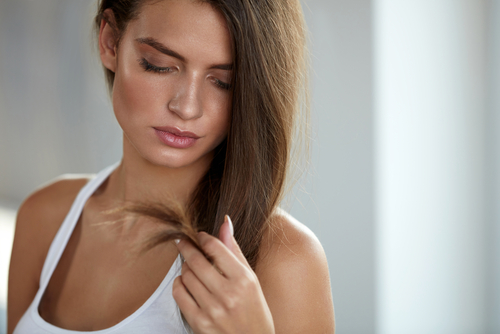 woman looking at split ends