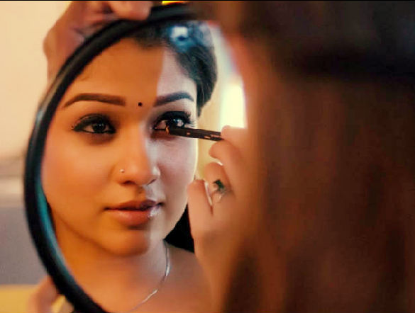 girl applying kajal