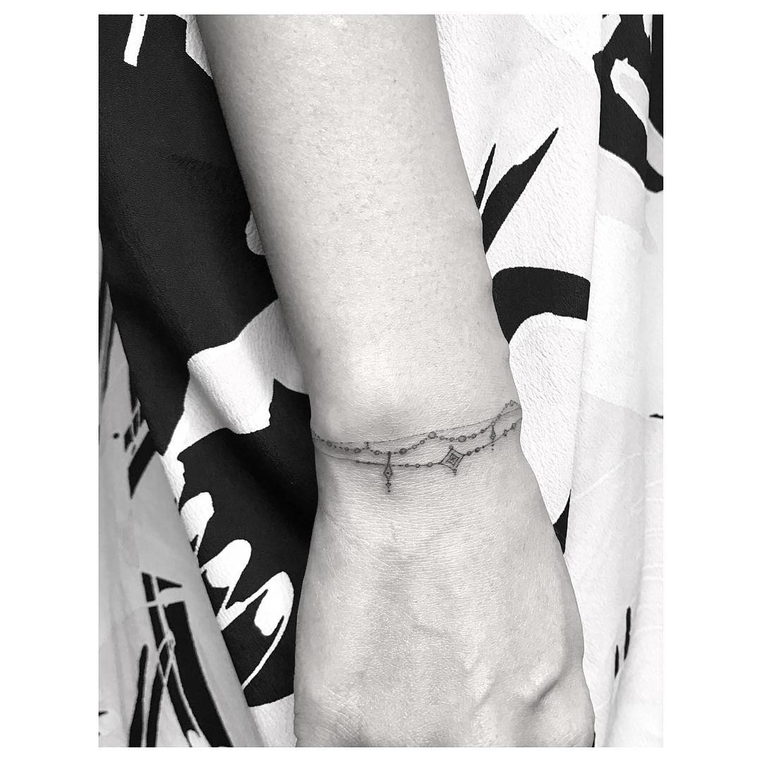 1-tattoo-ideas-wrist-tattoo-bracelet