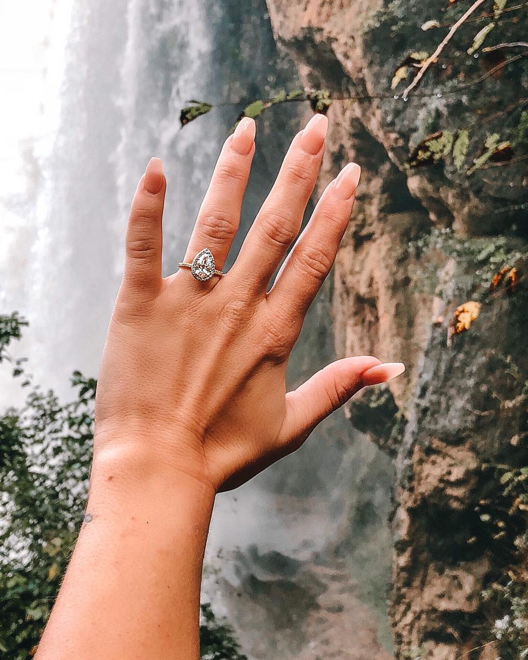 brides-flaunting-engagement-rings-waterfall