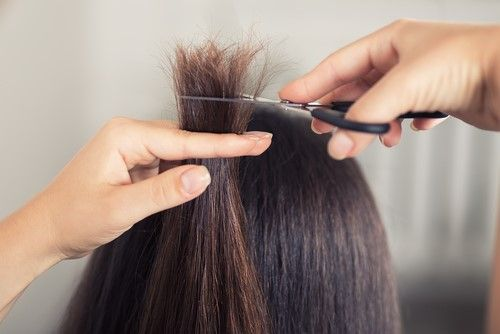 Girl cutting her split ends hair