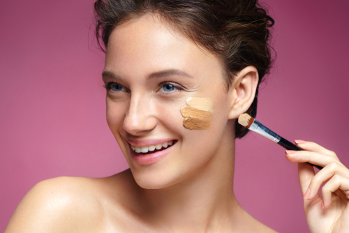 woman-applied-two-shades-of-cc-cream-on-her-face