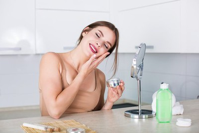 Girl using food face mask