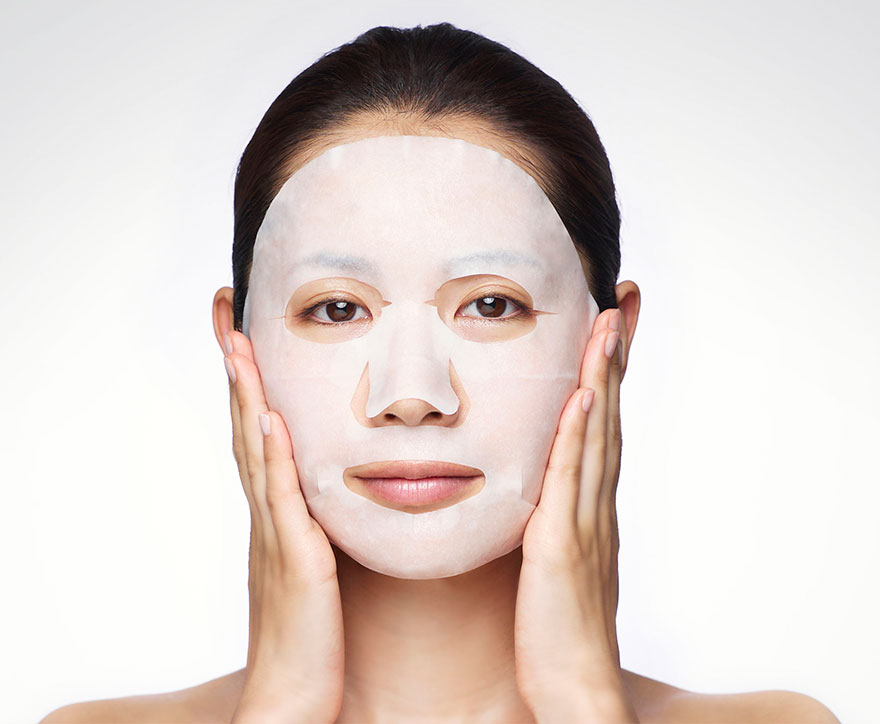 Girl applying Sheet mask