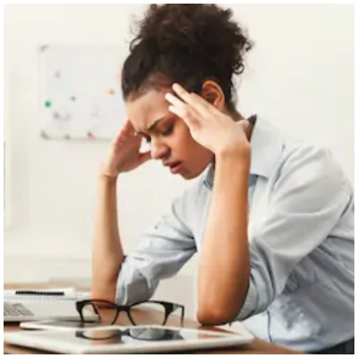 Girl suffering from migraine pain