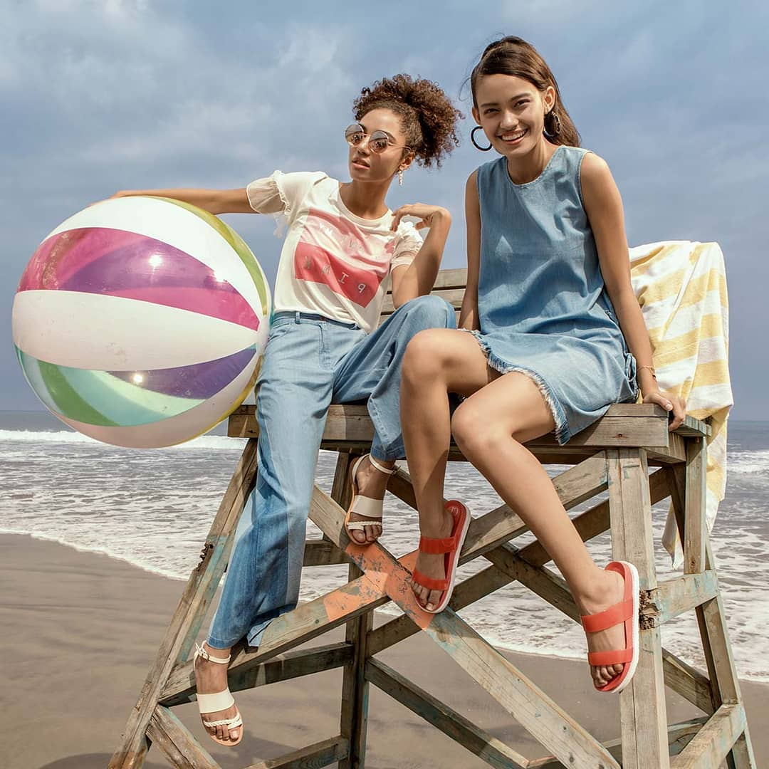 Two girls wearing clothes by Jabong