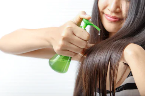 Girl using hair serum