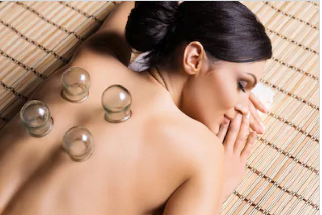 A girl having cupping therapy session