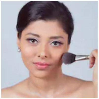 Girl using cosmetic products on face