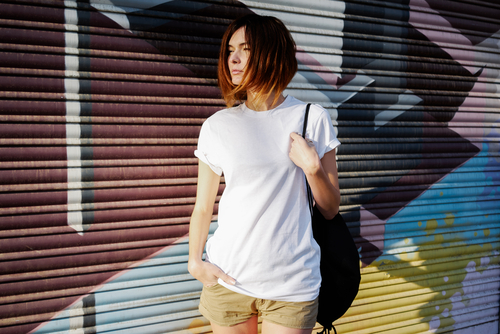 12 words every stylish girl should know - woman in white tee looking away
