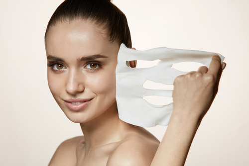 5 pack for your wedding night - woman removing a sheet mask
