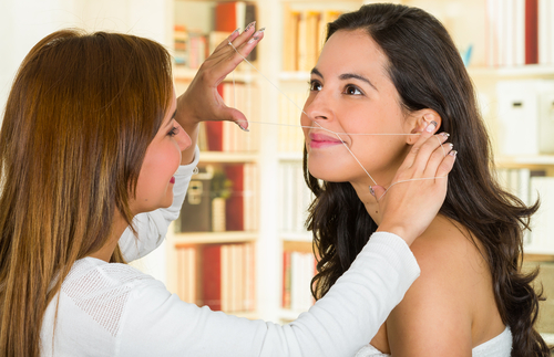 9 avoid bridal beauty disasters - woman getting upper lip hair removal
