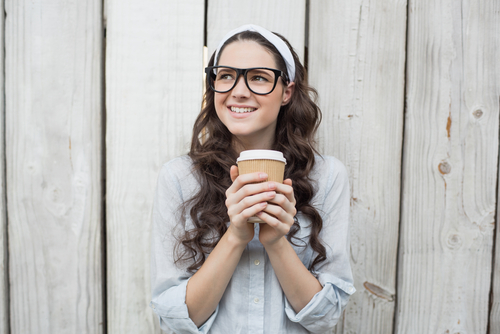 3 unexpected things girls wear that guys love - young woman pretty hairband holding glass