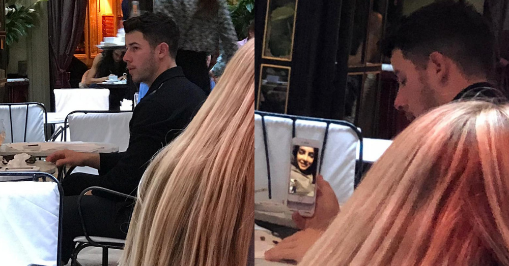 EXCLUSIVELY SPOTTED: Nick Jiju FaceTiming Priyanka At A Restaurant In Paris!