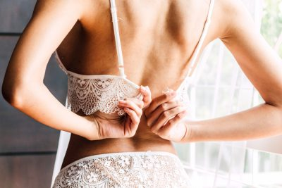 How to measure bra size - girl checking the fitting of her lace bra