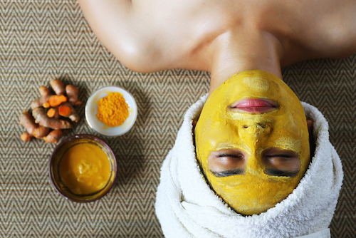 a-woman-is-making-avocade-face-mask