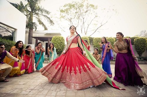 2 brides who wore red lehengas