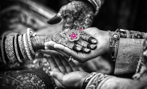 Internal 2 got married early - indian married couple hands