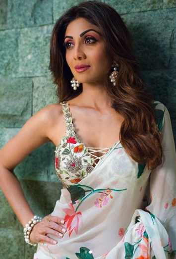 2 shilpa shetty floral saree wine red pink purple eye makeup posting against green wall instagram picture