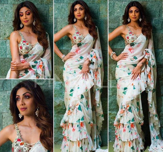 3 shilpa shetty floral saree wine red pink purple eye makeup posting against green wall instagram picture