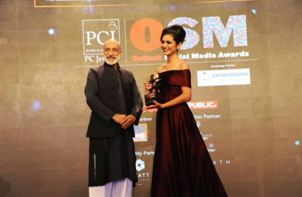 1 fb priya prakash varrier wins osm outlook social media viral personality of the year award recieveing at the award ceremony off shoulder maroon gown