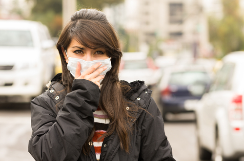 2 pollution - girl coughing
