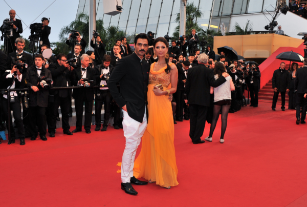 arjun Rampal with mehr jessia at the Chivas Red Carpet Cannes Film Festival