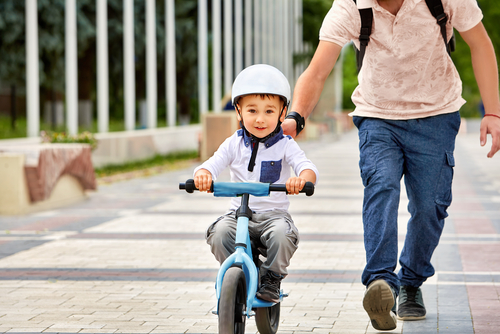 informal education - parent teaching kid to ride a bicycle - importance of education for women