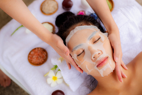 woman relaxing with sheet mask