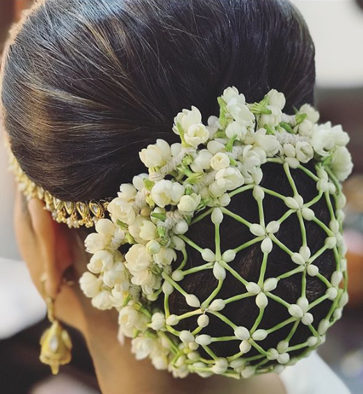 reception-hairstyle-floral-bun