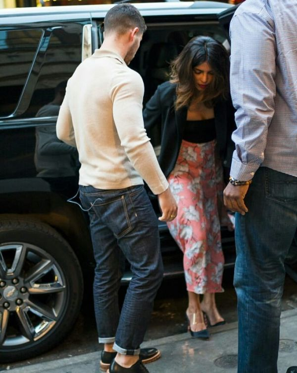 17-NickYanka-Candid-Pics-Nick-holding-the-door