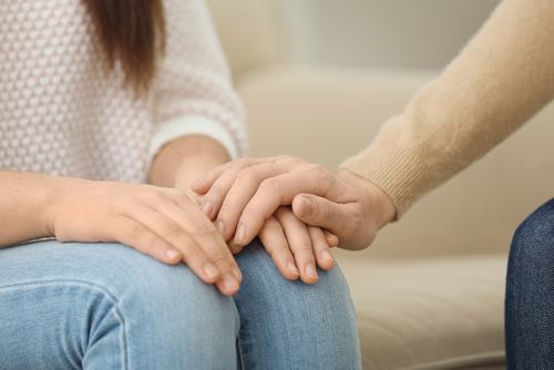 1-mental-health-woman-holding-hands