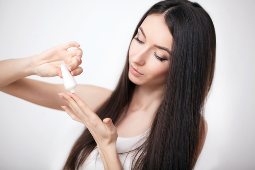 girl-pouring-bb-cream-on-her-hand