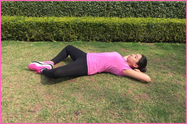 woman-lying-on-ground-doing-butterfly-stretch