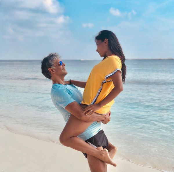 3 milind soman gets cozy with wife ankita