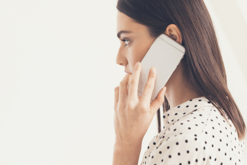 Internal fiance asked me to sneak out - woman talking on phone